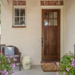 Greet neighbors, friends and family from this picturesque front porch.