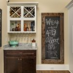 We love all the well-placed touches in this home that make it unique like this bar tucked right outside the kitchen within sight of the living space you'll be gathering in with friends.