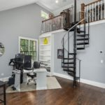 Heading upstairs, this large landing includes a cute loft space with circular staircase. So cute!