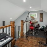The loft space would be perfect for a teen study space or….your drum set. :)