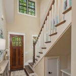 You will love the soaring ceiling and elegant staircase in your foyer - don't miss the cute door to the under the stairs storage and bench. It's just one of many features that will surprise and delight you about this home.