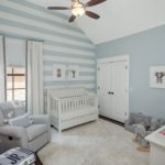 One of the three secondary bedrooms on the 2nd level - painted so cute with stripes.