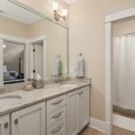 The 3rd full bath in this home includes double vanity and combination bath/shower.