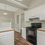 The electric stove, dishwasher and refrigerator convey with the property.