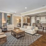 The heart of the home is featured here. This open floor plan is perfect for your entertaining needs along with being warm and comfortable as you share time with the important people in your life in this lovely room.