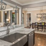 Chef quality stainless appliances, white subway tile and absolutely stunning white marble round out your new kitchen.