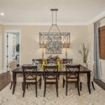 The separate and elegant dining room is just off the kitchen for your convenience. You'll enjoy more of the designer lighting fixtures here as well.